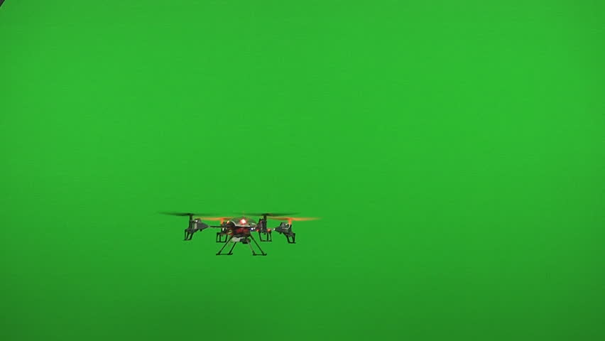Small drone flies in front of green screen