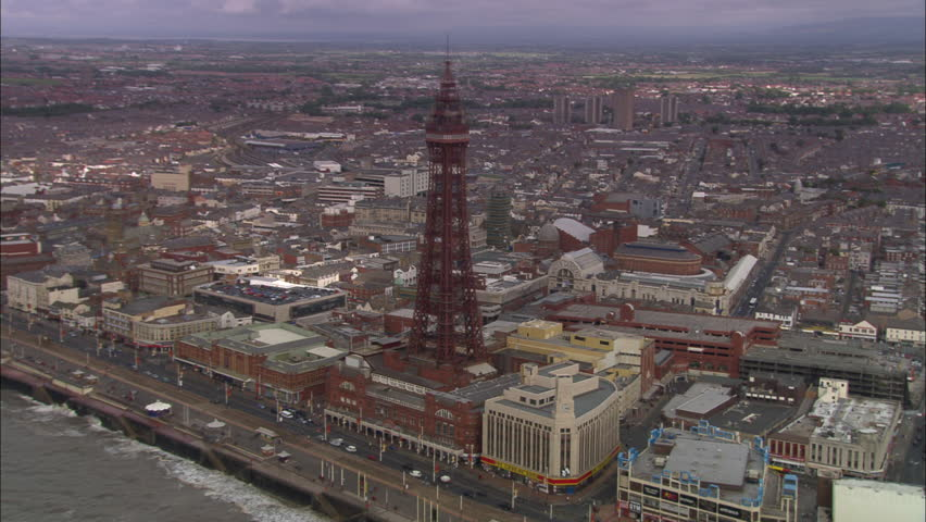 AERIAL United Kingdom-Blackpool Tower 2005: Run down Golden Mile from the north and back in closer shots