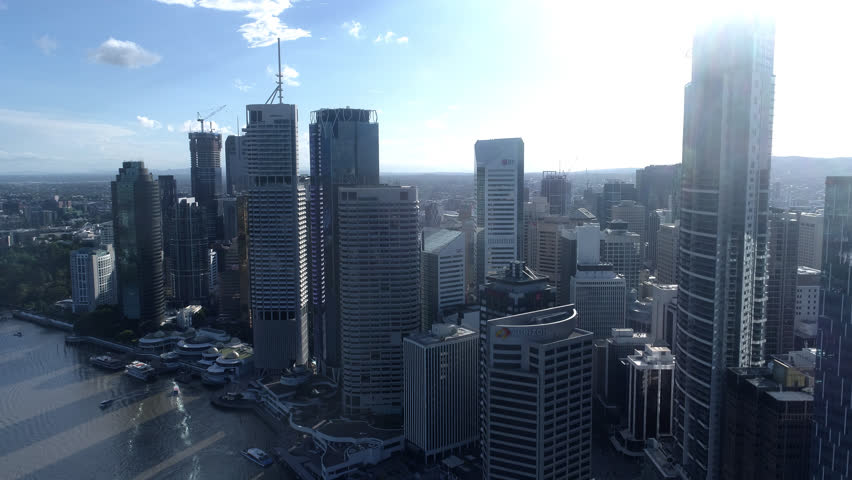 Aerial Shot of Brisbane City Late afternoon 4k source River City 1 of 21 in a set Cloudy & Blue Sky