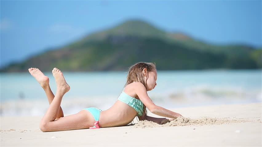 teen-girls-laying-on-the-beach-file-tube-porn
