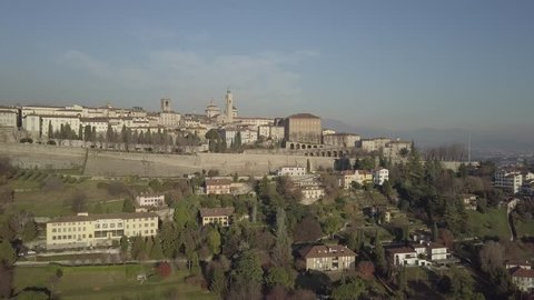 Aerial video shooting with drone on Bergamo, famous and ancient Lombardia city, founded on the hills