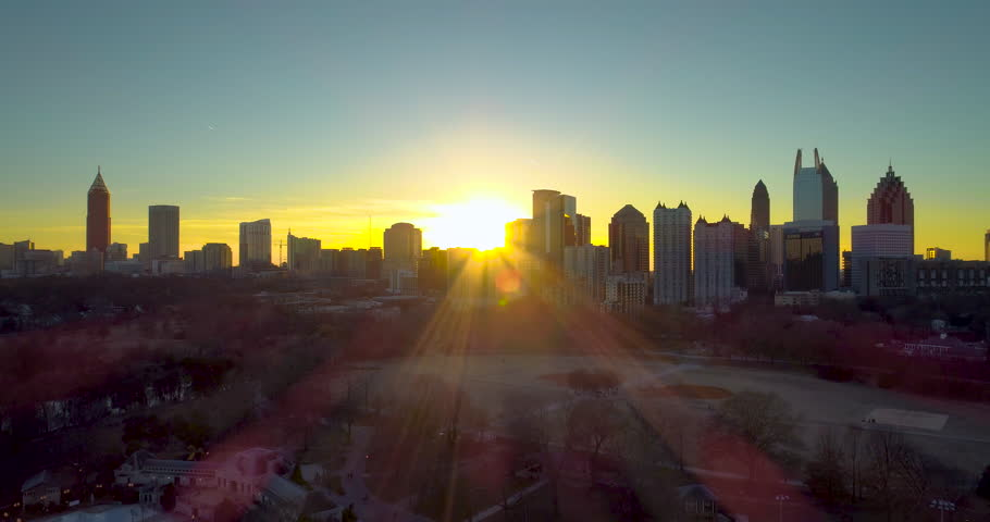 A beautiful shot of the Atlanta skyline from Piedmont Park that slowly rises to reveal a magnificent and colorful sunset!