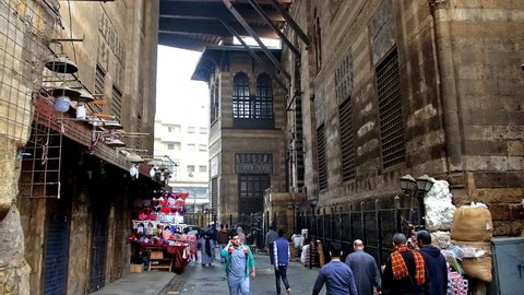 CAIRO, EGYPT - DECEMBER 21, 2017: Walk along AL-Muizz street through the complex of Sultan al-Ghuri, the notable landmark of Khan El Khalili Bazaar in Islamic Cairo district, on December 21 in Cairo.