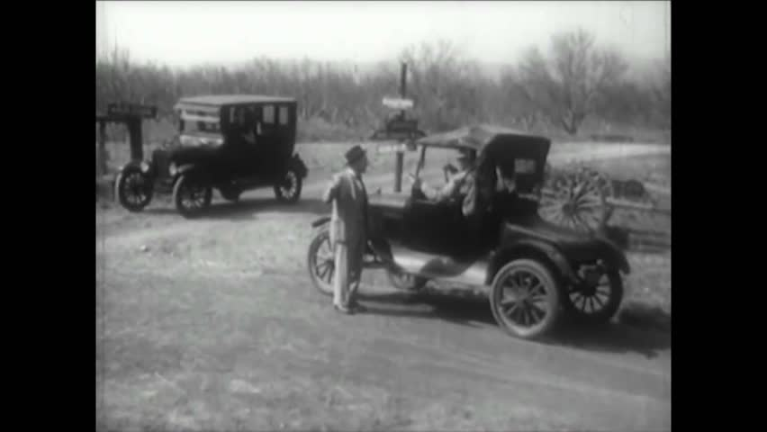 CIRCA 1900s - Roads in America are terrible in the 1900's but pavement improves the situation.