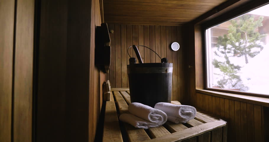 Location of a mountain wood sauna with a large window in which to relax. Concept of: interior design, relaxation, sauna, spa