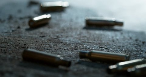Bullet casings falling to the floor in slow motion shot on Phantom Flex 4K at 1000fps