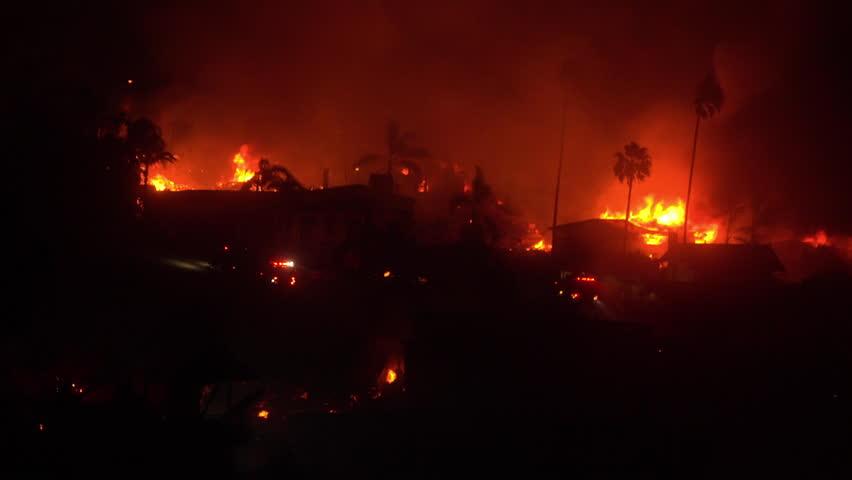 VENTURA, CALIFORNIA - CIRCA 2010s - Homes burn all across hillsides at night during the 2017 Thomas fire in Ventura County, California.