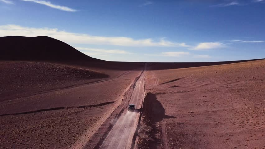 Aerial view of off-road truck riding in a dirt road
