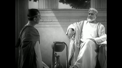 CIRCA 1930s - In this 1937 film, a scene set in ancient Rome depicts men arguing over the merits of a clock which runs on water.