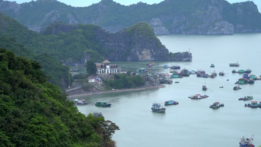 Panoramic landscape view of Cat Ba City of Cat Ba Island, Vietnam. A large number of traditional boats costs in the gulf at the island.