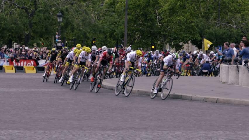 PARIS, FRANCE - JULY 23, 2017:Tour de France race peloton, slow mo finish Arc de Triomph Paris 2017 - HLG