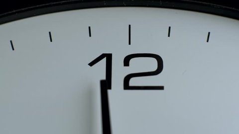 Close up- office clock. White wall clocks running. The movement of clock hands. Arrow 12 hours. Time for lunch