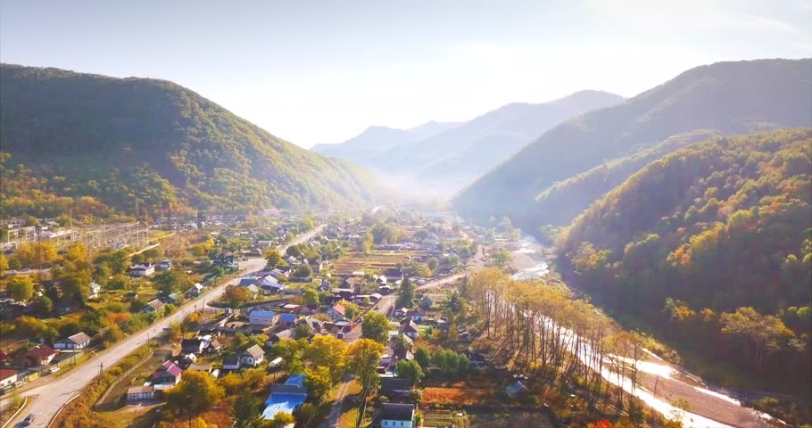 Flying above small city Dalnegorsk (far in the mountains) in Russian Far East. It's situated in the heart of Sikhote-Alin mountains range. Beautiful landscape with mounts and flowing stream. Aerial | Shutterstock HD Video #1006807627