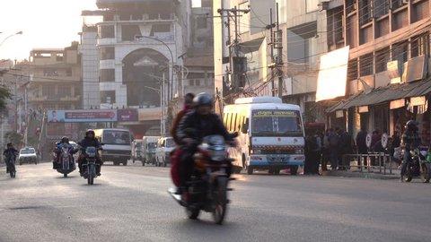 KATHMANDU, NEPAL - JAN 21: Motorbike, car and bus traffic in the inner city on January 21, 2018 in Kathmandu, Nepal
