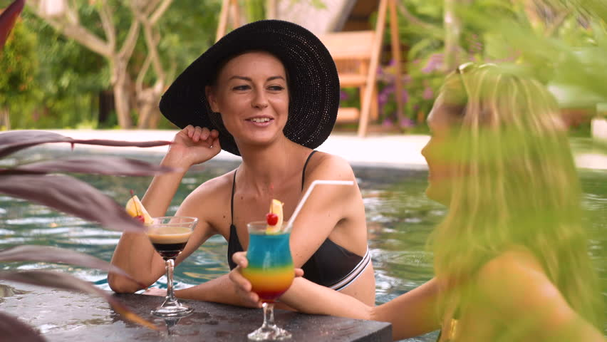 Bare women in pool