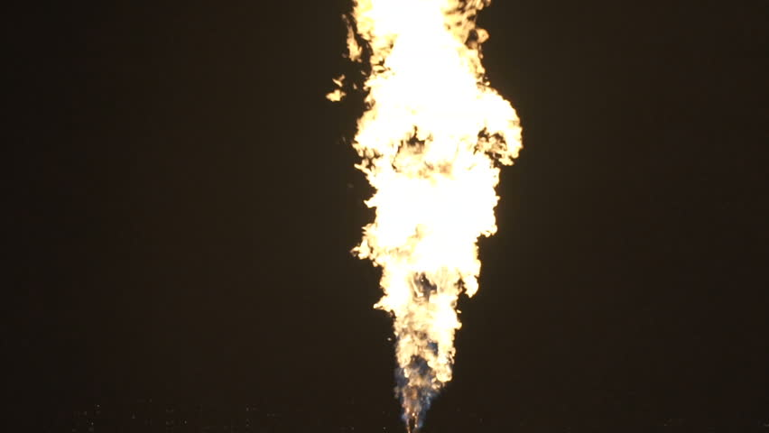 Fire ball explosion from bottom to top, fire flamethrower isolated on black background