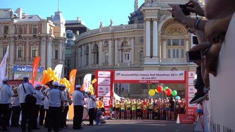 Odessa, Ukraine - 25th of June 2017: 4K At the ArcelorMittal Odessa Half Marathon 2017 - Runners listen to the national hymn before start