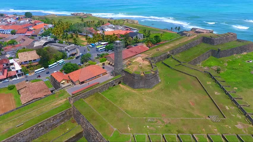 Fly around watch tower in Galle fort, Sri Lanka aerial