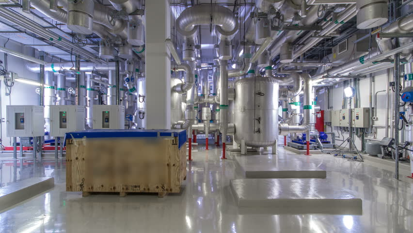 Equipment, cables and piping as found inside of industrial chiller plant room timelapse hyperlapse. Part of data center