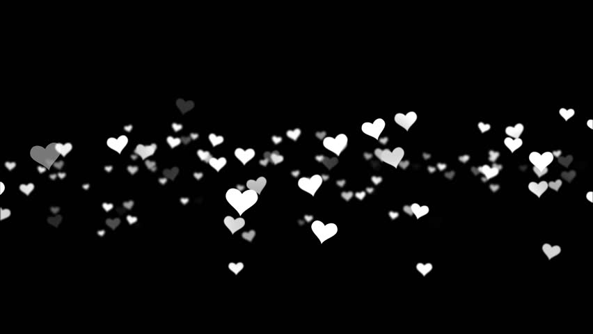 Red and white hearts over a black backdrop. Valentine's day motion background loop. Red small hearts flying on the black background. Valentines Day holiday abstract loop animation.