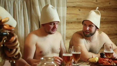 men drink beer in the bath