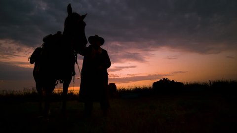Cinematic landscape silhouette of cowboy & his horse