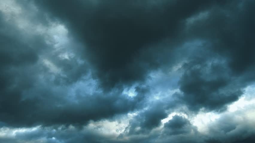 Early spring. Season change. Dark storm clouds