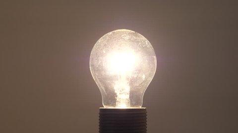 Incandescent light bulb turning on.