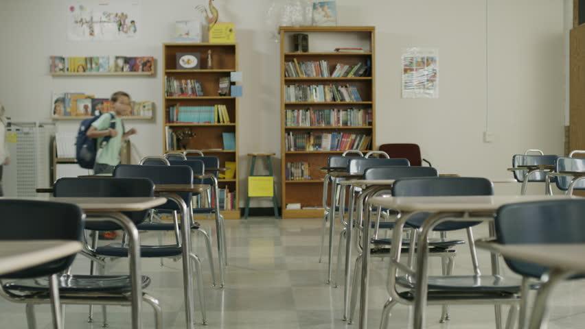 Panning shot of children arriving for start of class in elementary school / Provo, Utah, United States
