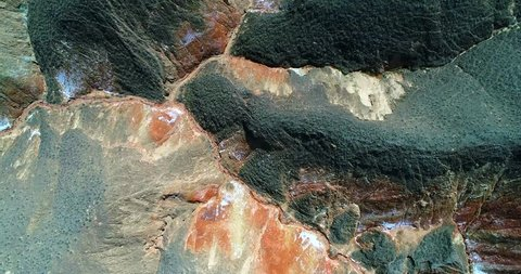 World's most amazing places. Aerial top down view on the colorful rainbow mountains of Zhangye Danxia landform geological park in Gansu province. Part 4 of a 9 part series-can be merged into 1 movie