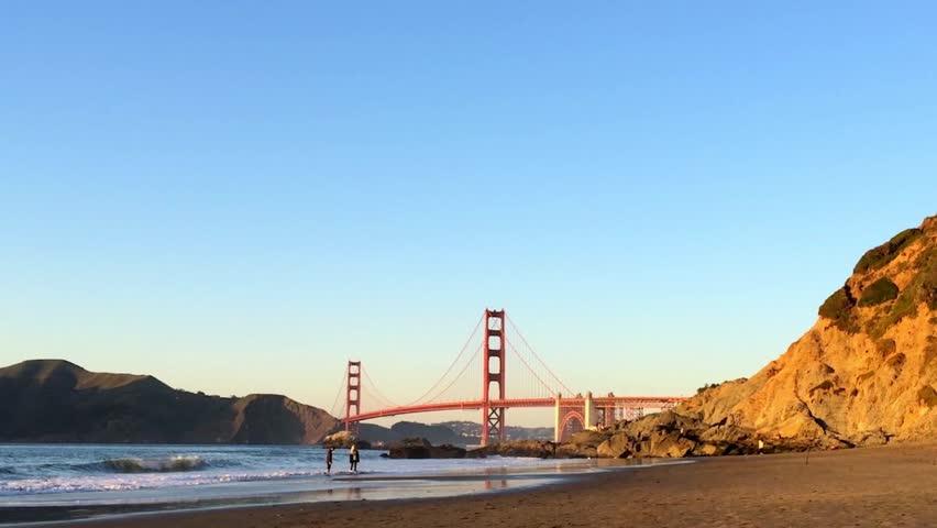 The Golden Gate Bridge as seen from Baker Beach at sunset, San Francisco, California, USA