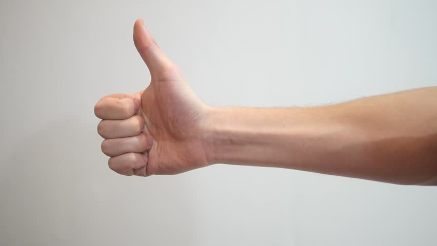 Hand giving thumbs up white background - Thumb up hand sign isolated on a white background