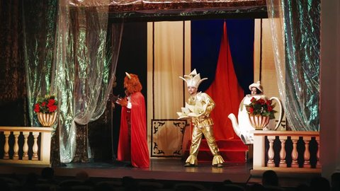 actors of the theater on stage - puppet show for children - disguised actors in beautiful costumes during the production of the play
