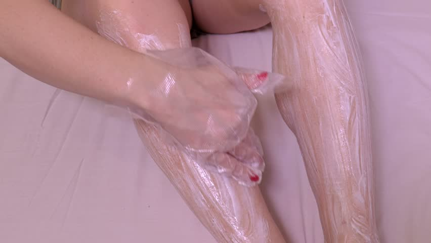 Woman smoothes out depilatory cream on legs   Shutterstock HD Video #1007169067