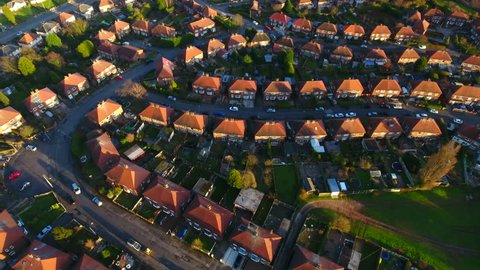 Aerial shot over the top of British housing estate in UK, English houses from above, semi detached homes