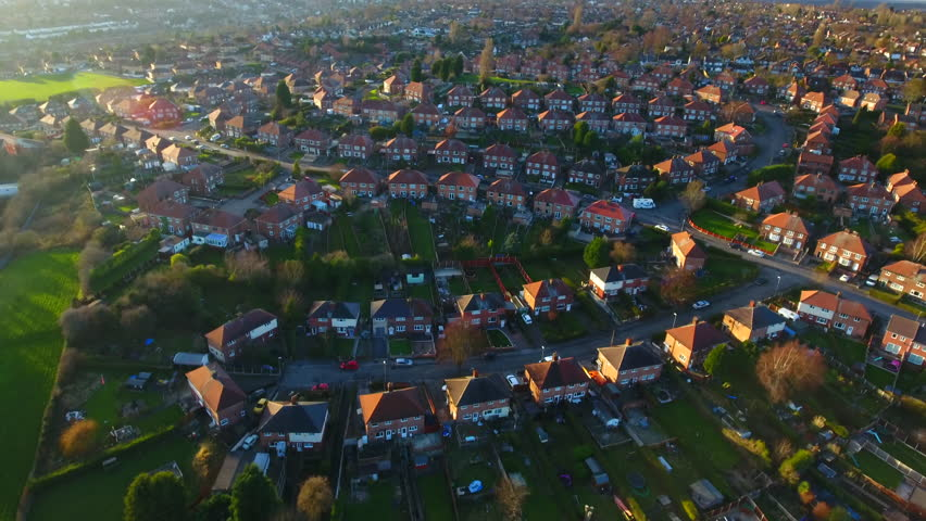 Aerial footage over a classic British housing estate, English houses and homes from above