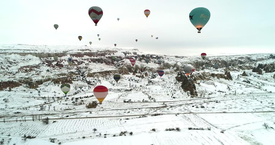 4K hot air balloons flying fairy chimney valley over Cappadocia Turkey at winter season, hot air bolloons trip at January 29th, 2018 Cappadocia Turkey