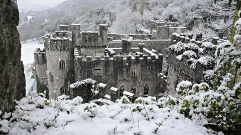 Gwrych Castle in snow, British European castle Snowing gently and covered in snowy winter landscape 5 of 6