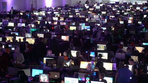 HELSINKI, FINLAND - JANUARY 03, 2017: A lot of gamers playing computer games in the great hall. The newest games and gadgets on ASSEMBLY in Messukeskus exhibition center.