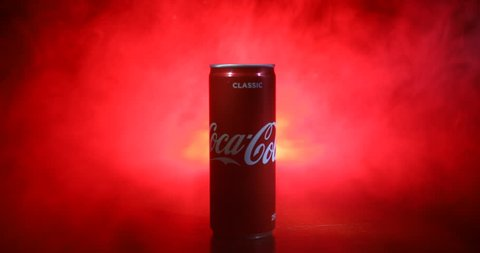 Baku, Azerbaijan 13th January 2018, Coca-Cola Classic in a can on dark toned foggy Background. Coca Cola, Coke is the most popular carbonated soft drink beverages sold around the world