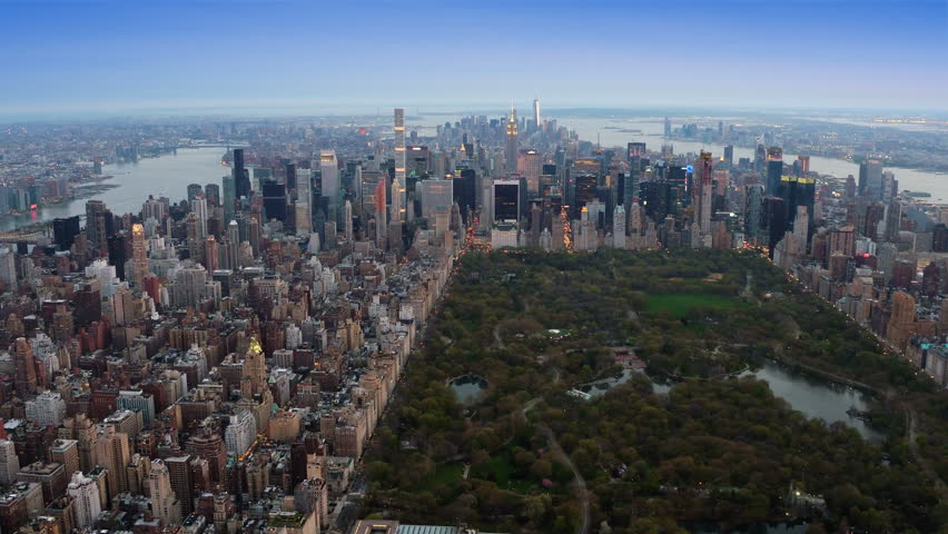Beautiful aerial view of the Central Park in Midtown Manhattan. Iconic skyscrapers as the Freedom Tower and the Empire State Building in the background. New York, United States. Shot from a helicopter