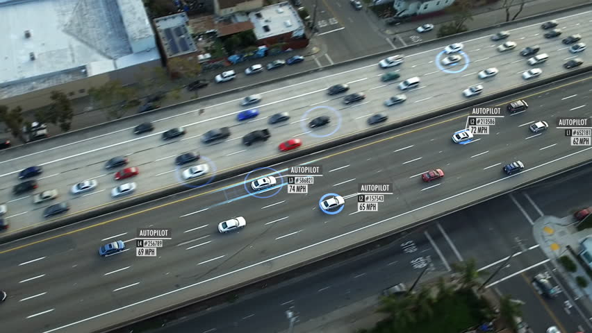 Driverless or autonomous car aerial view. Traffic passing by a highway. Plate number, miles per hour and fake ID number displaying. Future transportation. Artificial intelligence. Autopilot.