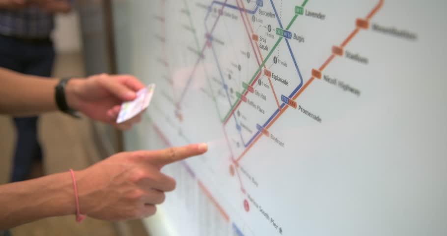 Finger Point on Singapore Metro Station Map