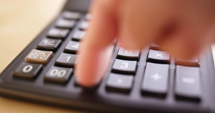 Using the calculator  | Shutterstock HD Video #1007302147