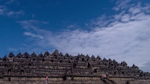 Time Lapse of Heritage Buddist temple Borobudur complex in Yogjakarta in Java, indonesia. Tilt from right to down