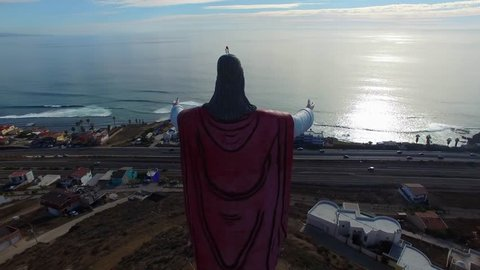 Aerial view of Christ of the Sacred Heart statue in the town of El Morro, south of the city of Rosarito, Baja California, Mexico.