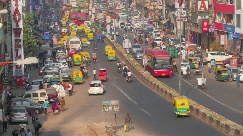 DELHI, INDIA - October 2017: Steadicam shot. View from roof on street traffic in Delhi, India.