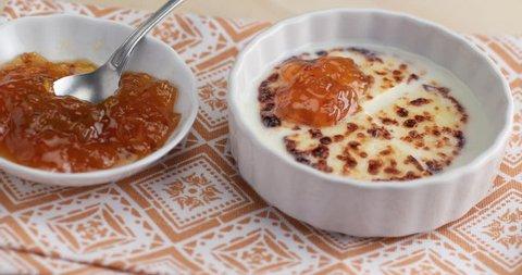 Finnish squeaky cheese Leipajuusto with milk and cloudberry jam