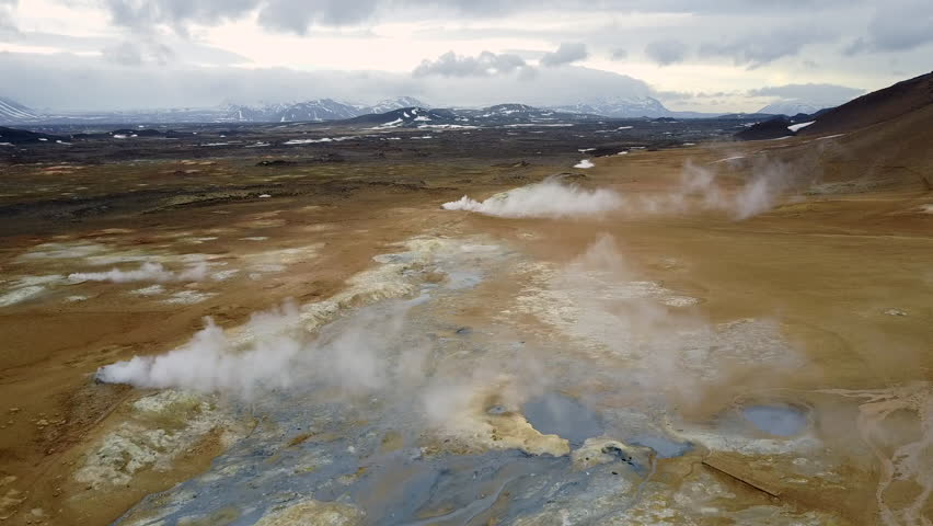 Aerial shot of the geothermal landform Hverir, with bubbling pools of mud and steaming fumaroles emitting sulfuric gas. Hverir, Iceland - 2017/04/30