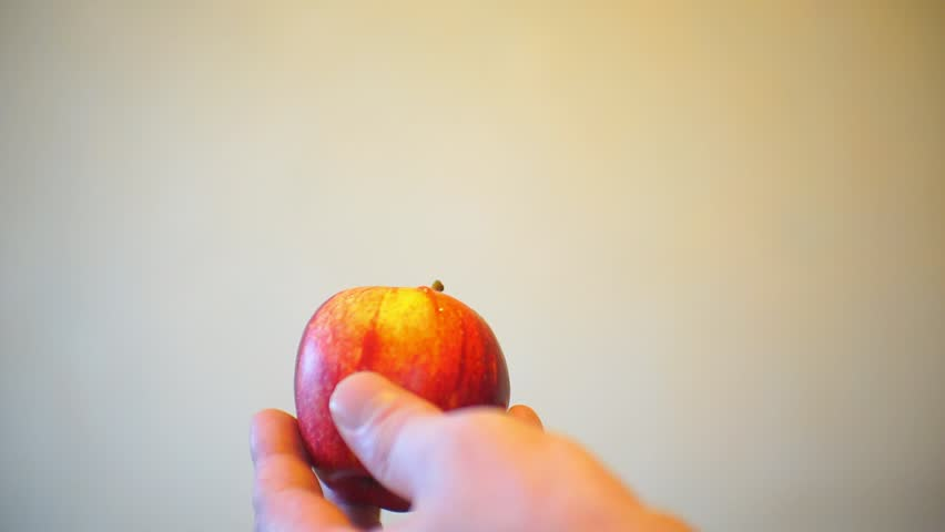 Male hands inject with a syringe into a ripe apple | Shutterstock HD Video #1007409967